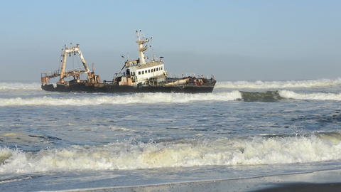 Sunken Ship In The Ocean Breakers Grounded At Namibia Coastline stock footage