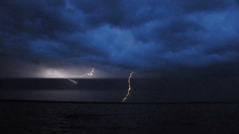 Thunderstorm and lightning over lake in the night Footage