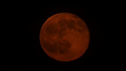 Blood Moon rising behind clouds Footage