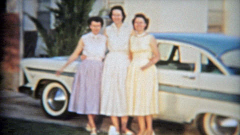1957: 3 sisters showing off famous 57' Plymouth brand new car Footage