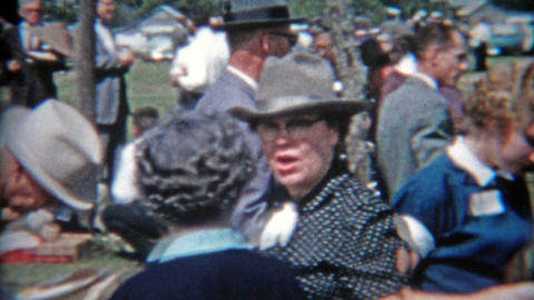 1957: Family reunion gathering people milling about in old time fashion Footage