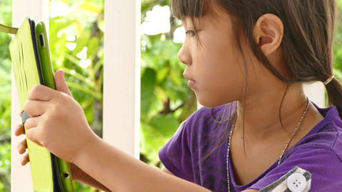 girl using touchscreen devices Live Action