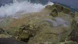 Fisheye, water over a rock towards camera Footage