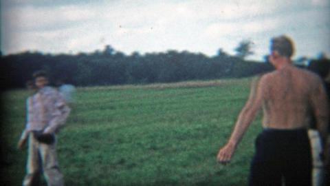 1948: Family pickup baseball game breaks out in farm fields Footage
