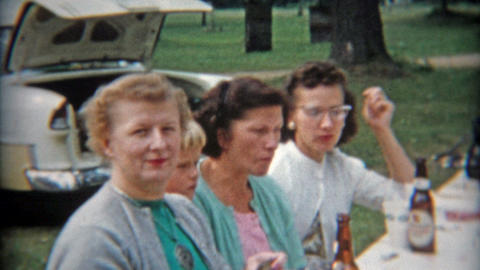 1942: Adult picnic drinking beer bottles outdoors Footage