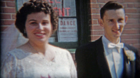 1942: Bride and Groom exiting church as a married couple Footage