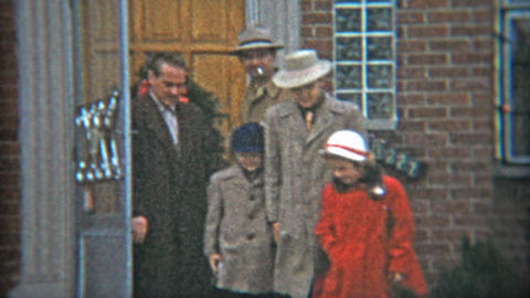 1953: Gangster fashion dressed up family leaving house in winter time Footage