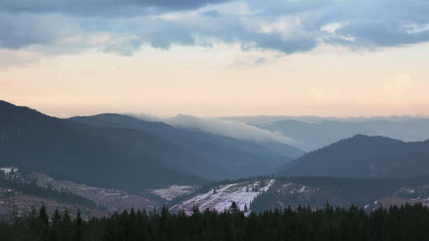 Beginning of Winter in the Forested Mountains. Time Lapse Footage