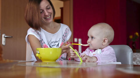 Beatiful girl feeds her baby Footage