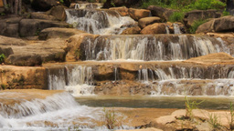 closeup mountain stream cascade among stones in park Footage