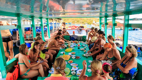 tourists take meal at large table on special tourist vessel Live Action