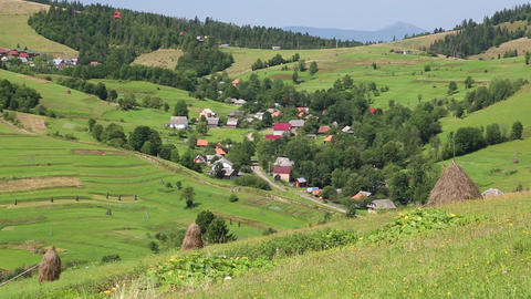 Beautiful green hills and village in Carpathians Footage