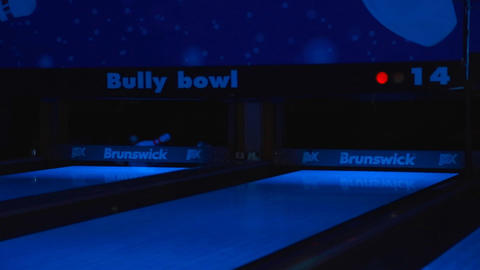 closeup - pin strike at neon bowling Footage