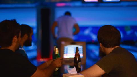 caucasion men drinking beer - neon bowling Footage