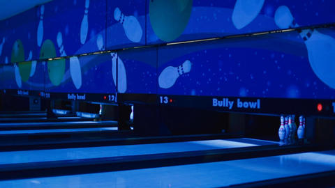 neon bowling ball knocking down pins Footage