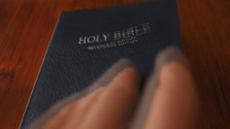 Opening the Holy Bible Footage
