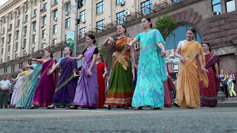 Women in Hindu traditional costumes, dancing and singing Hare Krishna mantra Footage