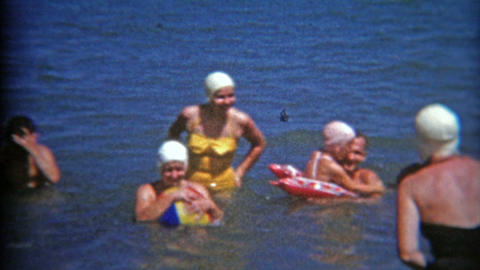 1953: Ladies all having swim caps when at the beach Footage