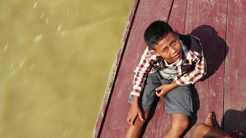 Cambodian boy on the boat which sails to the Tonle Sap lake in Cambodia Footage