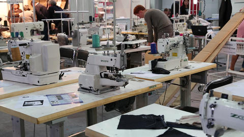 Stitching machines at clothing factory Footage
