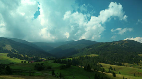 4K Timelapse of clouds and beautiful green fields Footage