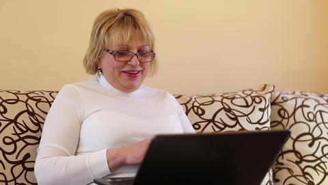Senior woman communicates through a laptop Footage