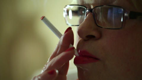 Senior Woman Smoking A Cigarette stock footage