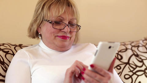 Woman using white smartphone Footage