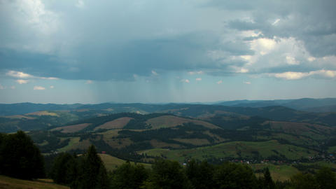 4K Timelapse of cumulonimbus clouds and rain in mountains Footage