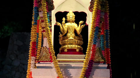 Golden statue of Phra Phrom or four-faced Buddha, Pattaya, Thailand Footage