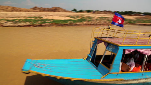Ship sails on the river to the Tonle Sap lake in Siem Reap province, Cambodia Footage