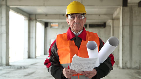 General foreman with building drawings at project site Footage