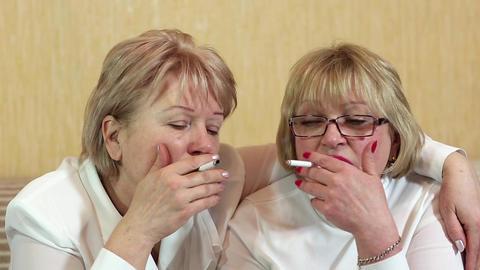 Two women smoke cigarettes Footage