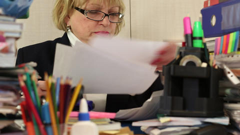 Woman as an administration economist in glasses tears commercial papers Footage
