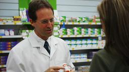 pharmacist with customer Footage