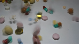Colorful Pills, Tablets And Capsules Falling Onto A Counter Top stock footage