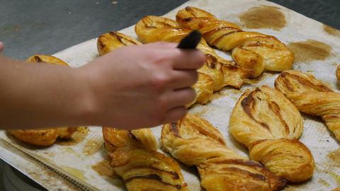 german bakery spread liquid sugar on a pastery roll 11674 Footage