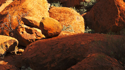 boulders at the base of uluru close up pan Footage