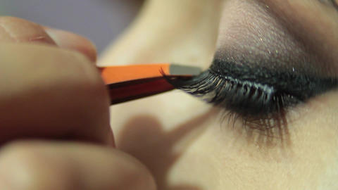 Eyelashe application during a makeup Footage