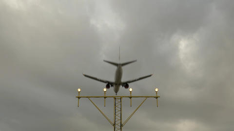 Airport Landing Lights And A Airplane Landing In Slow Motion stock footage