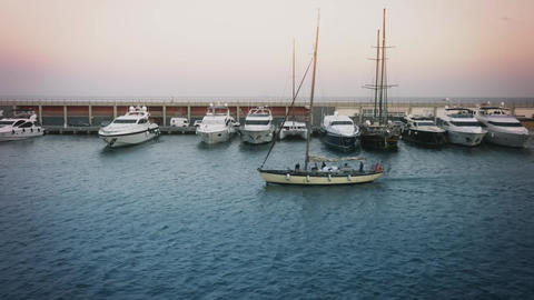 Boat Arriving At Marina Port Olympic In Barcelona At Dusk stock footage