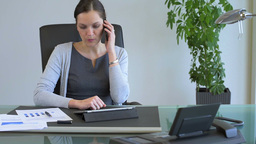 Business Woman Calling With Mobile Phone In Office stock footage