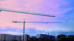 Bucharest, Romania - October 2015 Cranes Working For A New Mall At Dusk, Zoom Ou stock footage