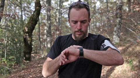 Runner Looks At Smart Watch stock footage