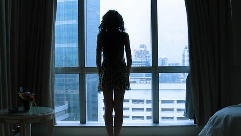 girl opens the curtains in the morning Stock Video Footage