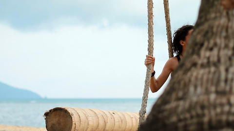 girl on the swing by the sea Stock Video Footage