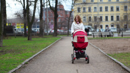 Mother WIth Baby Pram in Park Stock Video Footage