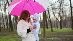 Mother and Baby in Park Stock Video Footage