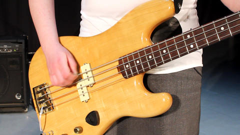 Close-up of female hand, playing the bass guitar Stock Video Footage