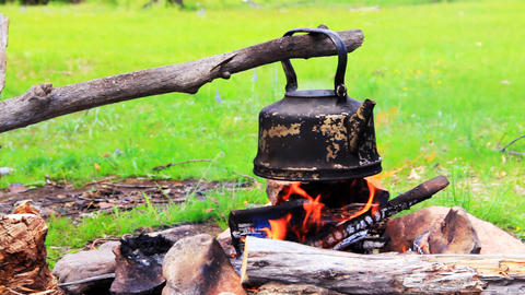 Smoky tourist kettle on fire in camping picnic Stock Video Footage